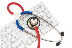 Stethoscope and keyboard of a computer Stock Image