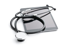 Stethoscope and computer tablet Royalty Free Stock Image