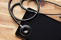 Stethoscope and computer tablet Stock Photos