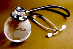 Stethoscope and crystal globe Royalty Free Stock Photo