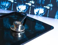 Stethoscope on digital tablet on x-ray images royalty free stock photography