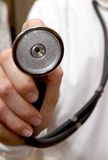 Stethoscope on doctor in white lab coat Stock Photo