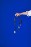 Stethoscope in doctors hand Royalty Free Stock Photo