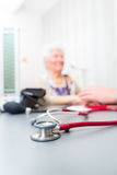 Stethoscope on doctors office desk Stock Photography