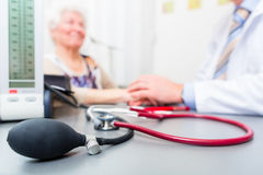 Stethoscope on doctors office desk Stock Images