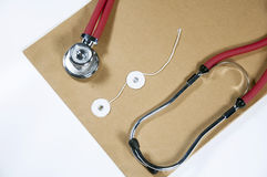 Stethoscope and document Royalty Free Stock Photos
