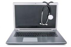 Stethoscope draped on laptop Royalty Free Stock Photography