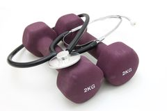 Stethoscope and dumbbell royalty free stock photos