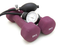 Stethoscope and dumbbell Stock Photos
