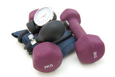 Stethoscope and dumbbell Royalty Free Stock Image