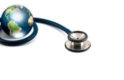 Stethoscope and earth Stock Photography