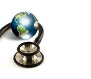 Stethoscope and earth Royalty Free Stock Image