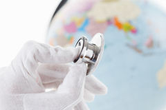 Stethoscope and Earth globe as symbol of care for environment. Royalty Free Stock Photos