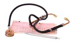 Stethoscope and ECG. Stethoscope and Electrocardiogram print. White background Royalty Free Stock Photo