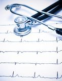 Stethoscope and ECG chart. Blue tint stock images
