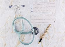 Stethoscope ECG graph and pen Royalty Free Stock Photography