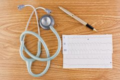 Stethoscope ECG graph and pen Royalty Free Stock Images