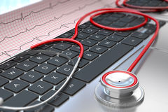 Stethoscope and ECG on laptop keyboard Royalty Free Stock Photography