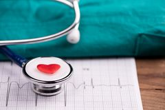 A stethoscope on ecg medical report stock photo