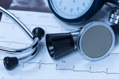 Stethoscope And Electrocardiogram Stock Photos