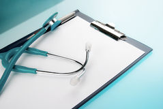 Stethoscope and empty document in a clipboard Royalty Free Stock Image