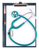 Stethoscope and empty document in a clipboard isolated Royalty Free Stock Image