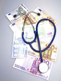Stethoscope and euro Stock Image