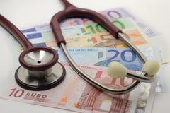 Stethoscope and euro Stock Image