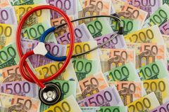 Stethoscope and euro banknotes Stock Photos
