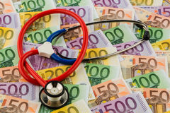 Stethoscope and euro bills Stock Photos