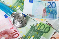 Stethoscope and euro money. Royalty Free Stock Image