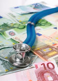 Stethoscope and euro money. Royalty Free Stock Photo