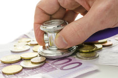 Stethoscope on European currency Royalty Free Stock Photos