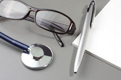 Stethoscope, Eye Glass, Pen and Book Note Stock Photos