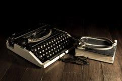 Stethoscope with eyeglasses book and typewriter. stock image