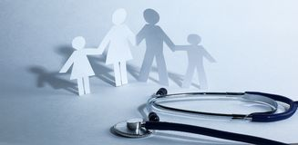 Stethoscope and the family paper doll.the concept of health. Photo with copy space Stock Photos
