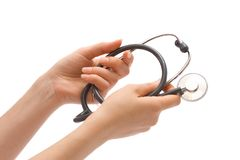 Stethoscope in female hands Royalty Free Stock Photo