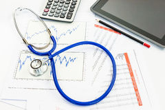 Stethoscope with financial graph Stock Photo