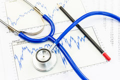 Stethoscope with financial graph Stock Photography