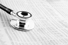 Stethoscope on financial newspaper Royalty Free Stock Photography