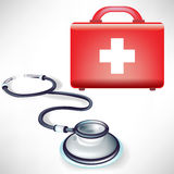Stethoscope with first aid kit Royalty Free Stock Photography