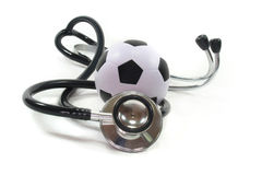 Stethoscope with football Royalty Free Stock Photos