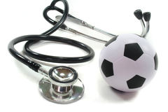 Stethoscope with football Stock Image