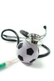 Stethoscope with football and syringe Stock Images