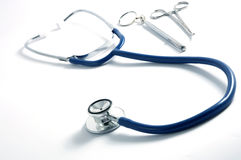 Stethoscope and forceps Stock Photography