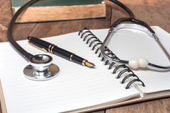 Stethoscope and fountain pen royalty free stock photo