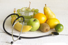 Stethoscope and fresh fruits diet concept Stock Photography