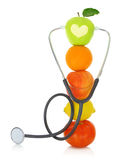Stethoscope with fresh fruits Stock Images