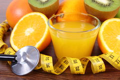 Stethoscope, fresh fruits, juice and centimeter, healthy lifestyles and nutrition Royalty Free Stock Images