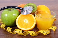 Stethoscope, fresh fruits, juice and centimeter, healthy lifestyles and nutrition Royalty Free Stock Image